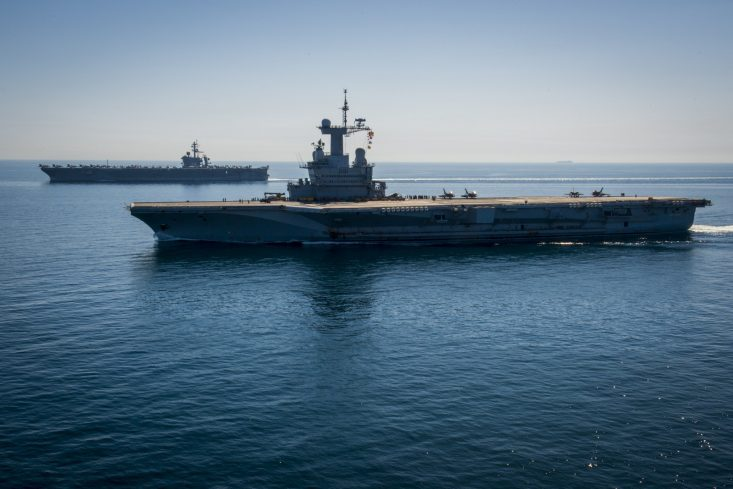 150308-N-HD510-106 ARABIAN GULF (March 8, 2015) The aircraft carrier USS Carl Vinson (CVN 70), left, and the French nuclear aircraft carrier Charles de Gaulle (R91) transit the Northern Arabian Gulf. Carl Vinson is deployed in the U.S. 5th Fleet area of responsibility supporting Operation Inherent Resolve, strike operations in Iraq and Syria as directed, maritime security operations, and theater security cooperation efforts in the region. (U.S. Navy photo by Mass Communication Specialist 2nd Class Scott Fenaroli/Released)